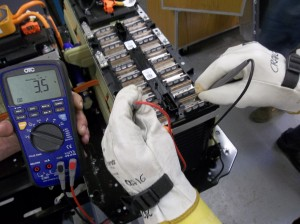 Testing the voltage of one of 96 modules after removing a VOLT battery