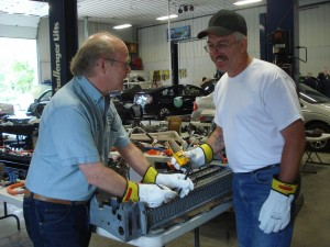 Craig Van Batenburg (left) explains HV battery to technician