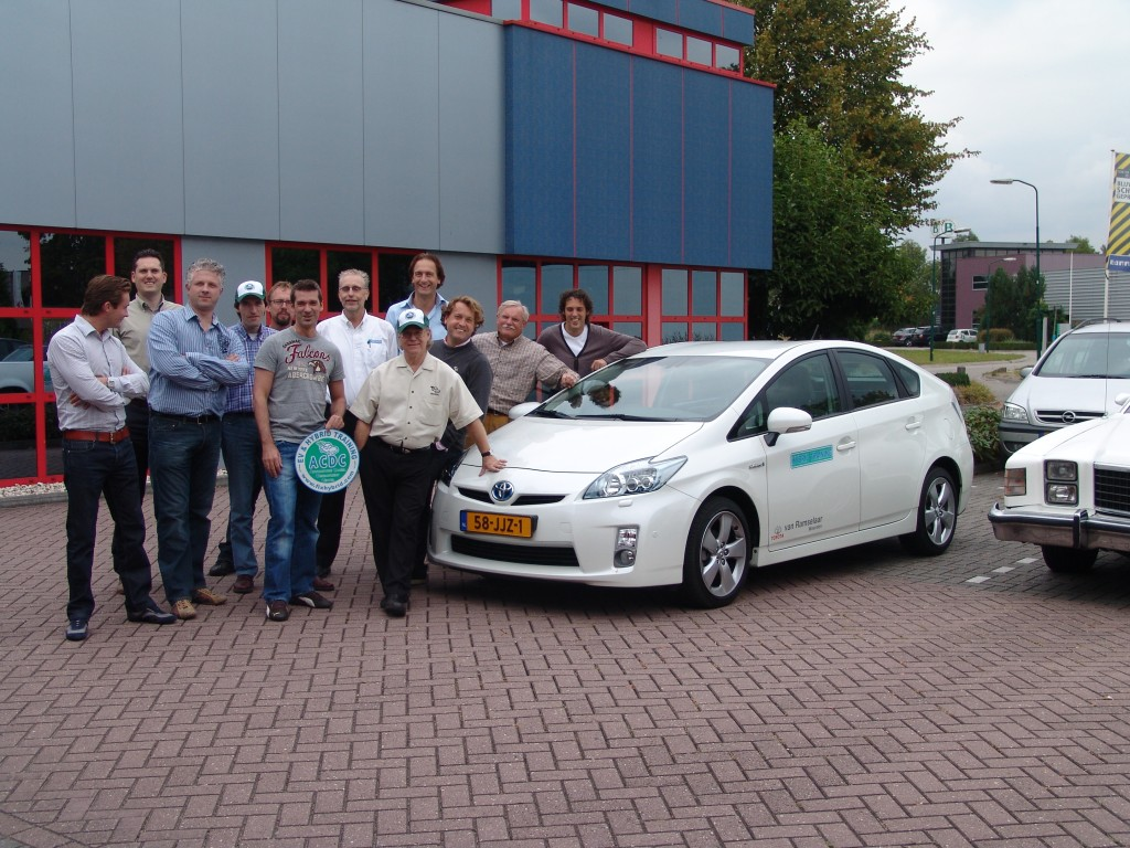 Craig van Batenburg, leaning on the hood of a Prius, in the Netherlands at Midtronics office.